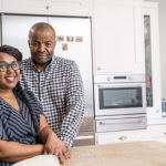 one black couple in their kitchen